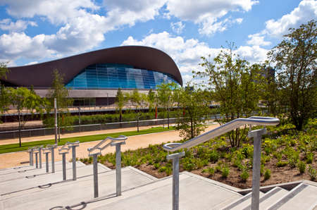 The impressive Aquatics Centre located in the Queen Elizabeth Olympic Park beside the Waterworks River in Stratford, London.