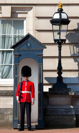 LONDON, UK - MAY 16TH 2014: A Queens Guard outside the historic Buckingham Palace in London on 16th May 2014.