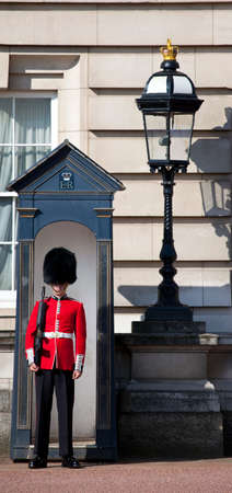 prince charles of england: LONDON, UK - MAY 16TH 2014: A Queens Guard outside the historic Buckingham Palace in London on 16th May 2014. Editorial