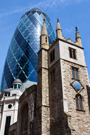 30 st mary axe: The historic St. Andrew Undershaft Church with 30 St. Mary Axe towering above it in the City of London.
