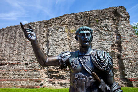 A statue of Roman Emperor Trajan with remains of London Wall which was first built by the Romans in the 2nd and 3rd Centuries AD.