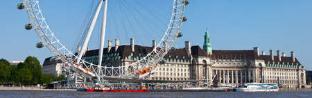 LONDON, UK - MAY 18TH 2014: A panoramic view of the magnificent London Eye and County Hall in London on 18th May 2014.