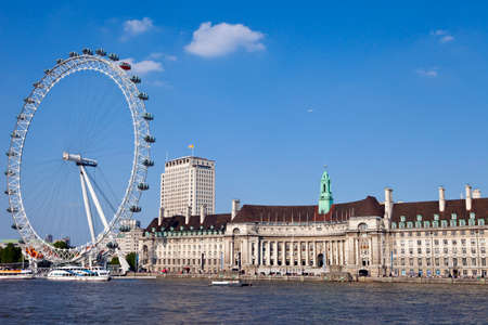 LONDON, UK - MAY 18TH 2014: A view of the magnificent London Eye, County Hall and the River Thames in London on 18th May 2014.