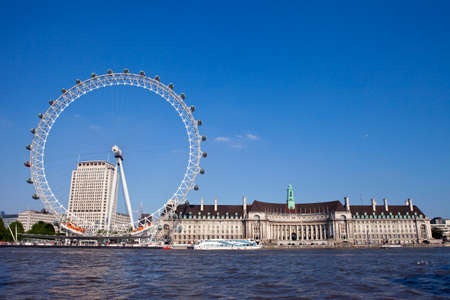 river county: LONDON, UK - MAY 18TH 2014: A view of the magnificent London Eye, County Hall and the River Thames in London on 18th May 2014.