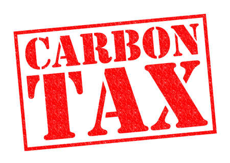 CARBON TAX red Rubber Stamp over a white background. 版權商用圖片