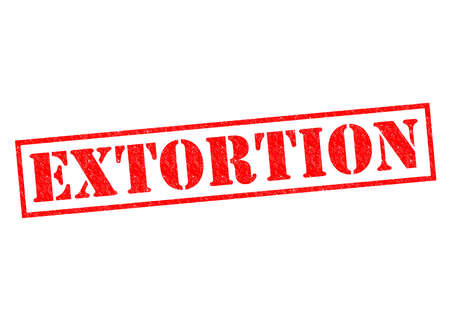 extortion: EXTORTION red Rubber Stamp over a white background.