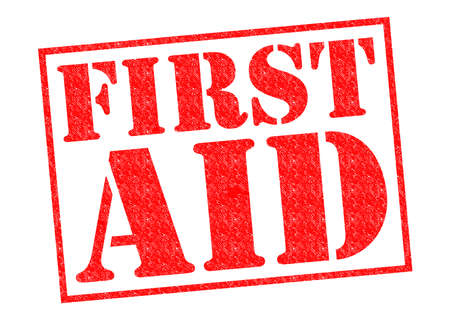FIRST AID red Rubber Stamp over a white background. photo