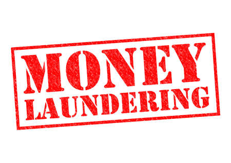 MONEY LAUNDERING red Rubber Stamp over a white background.