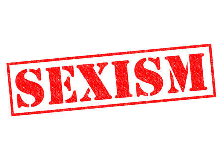 genders: SEXISM red Rubber Stamp over a white background. Stock Photo