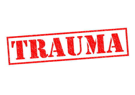 distressing: TRAUMA red Rubber Stamp over a white background.
