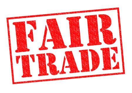 fairtrade: FAIR TRADE red Rubber stamp over a white background. Stock Photo