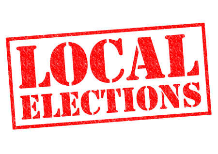 local election: LOCAL ELECTIONS red Rubber Stamp over a white background. Stock Photo