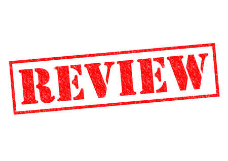 oversee: REVIEW red Rubber Stamp over a white background. Stock Photo