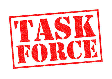TASK FORCE rode Rubber Stamp over een witte achtergrond. Stockfoto