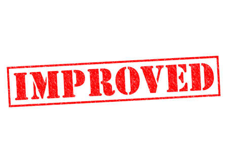 new and improved: IMPROVED red Rubber Stamp over a white background. Stock Photo