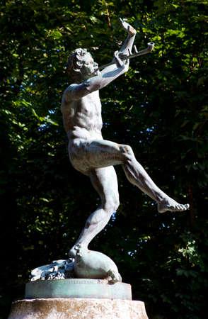 faun: The Faune Dansant (Dancing Faun) statue by sculptor Eugne-Louis Lequesne in Pariss Jardin du Luxembourg. Stock Photo
