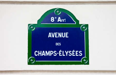 A Street sign for Avenue des Champs-Elysees in Paris. photo