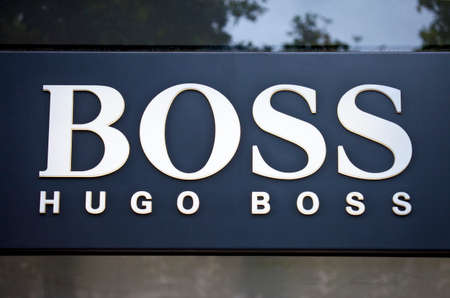 highfashion: PARIS, FRANCE - AUGUST 4TH 2014: The sign for the Hugo Boss store on Avenue des Champs-Elysees in Paris on 4th August 2014.  The Hugo Boss company was founded in 1924 and sells luxury high-fashion.