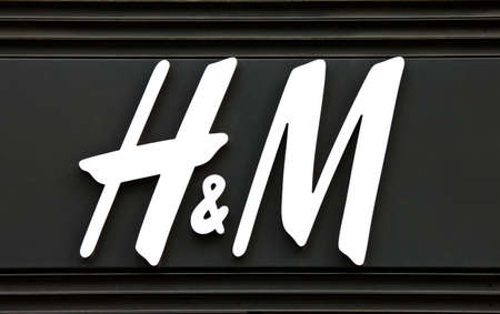 hm: PARIS, FRANCE - AUGUST 4TH 2014: The sign for the H&M fashion store on Avenue des Champs-Elysees in Paris on 4th August 2014.  Founded in 1947, H&M currently exists in 53 countries worldwide.