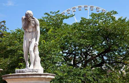 henri: A sculpture by Henri Vidal in the beautiful Jardin des Tuileries in Paris, France. Editorial