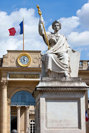 La Statue de la Loi with the French National Assembly (Palais Bourbon) in the background in Paris. photo