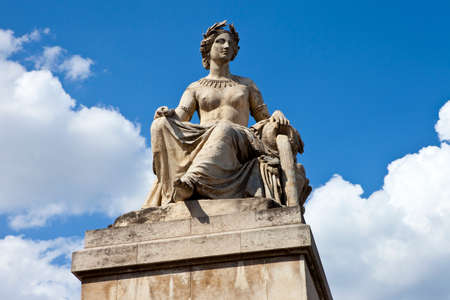 carrousel: One of the statues on Pont du Carrousel in Paris, France.