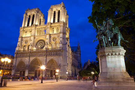 ile de la cite: The beautiful Notre Dame Cathedral and Charlemagne statue in Paris. Editorial