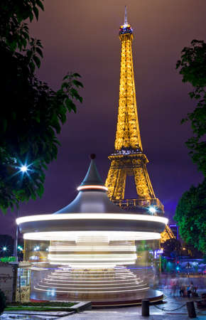 PARIS, FRANCE - AUGUST 8TH 2014: A vintage Carousel with the Eiffel Tower in the background in Paris on the 8th August 2014.