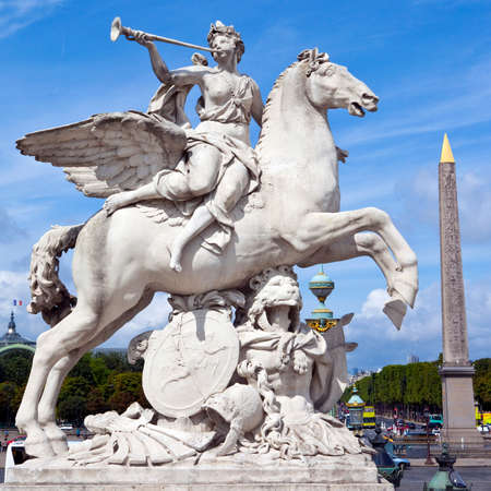A statue from the Tuileries Garden in Paris.  The obelisk of Luxor in Place de la Concorde can be seen on the right-handside.