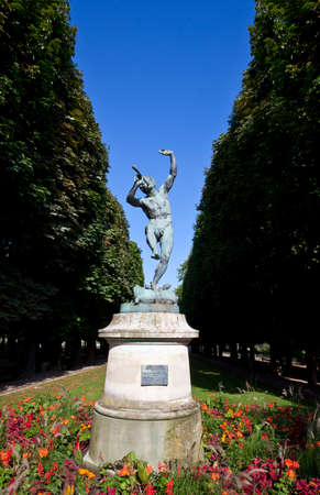 faun: The Faune Dansant (Dancing Faun) statue by sculptor Eugene-Louis Lequesne in Pariss Jardin du Luxembourg. Editorial
