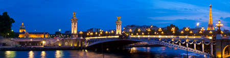 Panoramic view taking in the sights of Les Invalides, Pont Alexandre III and the Eiffel Tower in Paris, France.