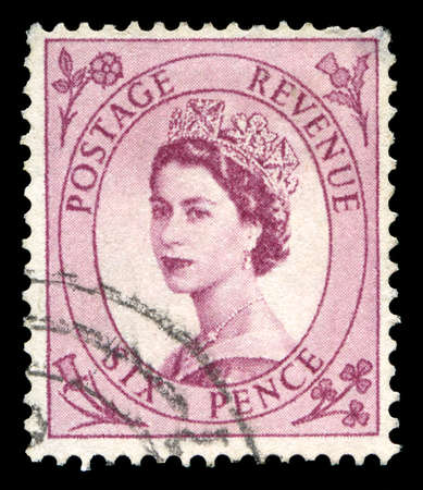 UNITED KINGDOM, CIRCA 1950s: A vintage British postage stamp depicting a portrait of Queen Elizabeth II, circa 1950s.