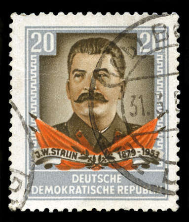 EAST GERMANY - CIRCA 1950s: A vintage postage stamp from the Deutsche Demokratische Republik (East Germany) featuring a portrait of Soviet Union leader Jospeh Stalin, circa 1950s.