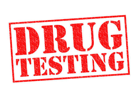 DRUG TESTING red Rubber Stamp over a white background. Stock Photo
