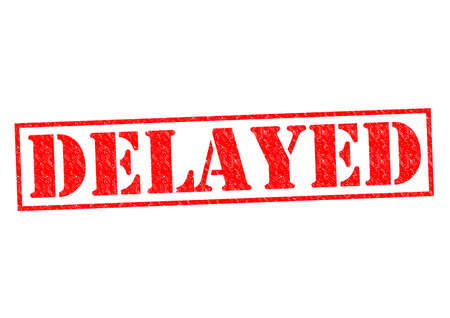 DELAYED red Rubber Stamp over a white background. photo