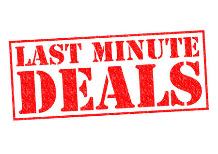 last minute: LAST MINUTE DEALS red Rubber Stamp over a white background. Stock Photo