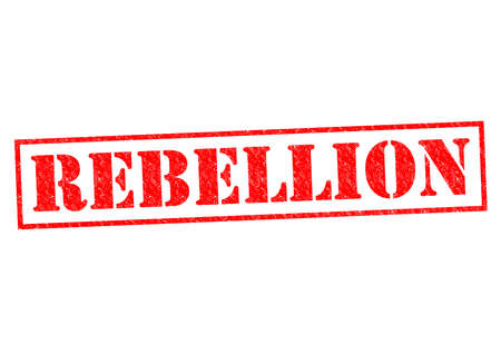 rebellious: REBELLION red Rubber stamp over a white background. Stock Photo