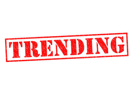 TRENDING red Rubber Stamp over a white background.
