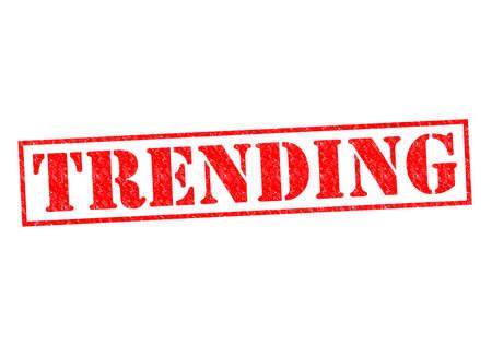 trending: Trending timbro di gomma rosso su uno sfondo bianco. Archivio Fotografico