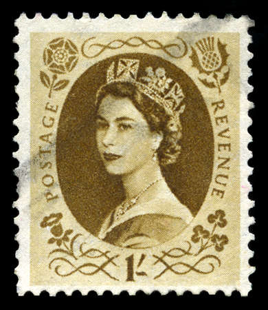 the majesty: UNITED KINGDOM, CIRCA 1950s: A vintage British postage stamp depicting a portrait of Queen Elizabeth II, circa 1950s.