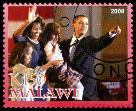 MALAWI - CIRCA 2008: A used Postage Stamp from Malawi depicting an image of Barack Obama (the 44th president of the United States of America) with his family, circa 2008.