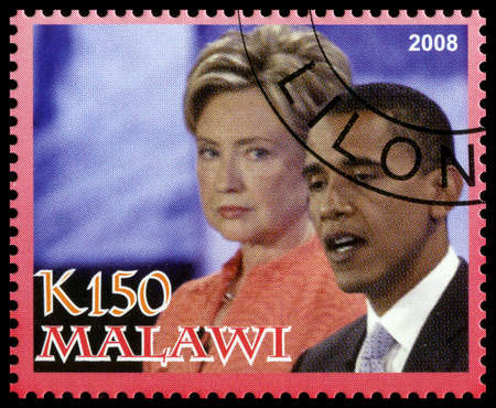 obama: MALAWI - CIRCA 2008: A used Postage Stamp from Malawi depicting an image of both Barack Obama (the 44th president of the United States of America) and Hillary Clinton, circa 2008.