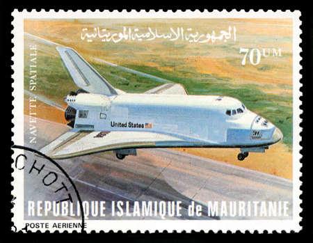 REPUBLIQUE ISLAMIQUE DE MAURITANIE - CIRCA 1981: Un timbre-poste vintage République Islamique de Mauritanie représentant une image de la navette spatiale, vers 1981. Éditoriale