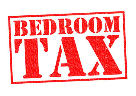 dues: BEDROOM TAX red Rubber Stamp over a white background. Stock Photo