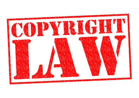 plagiarism: COPYRIGHT LAW red Rubber Stamp over a white background. Stock Photo