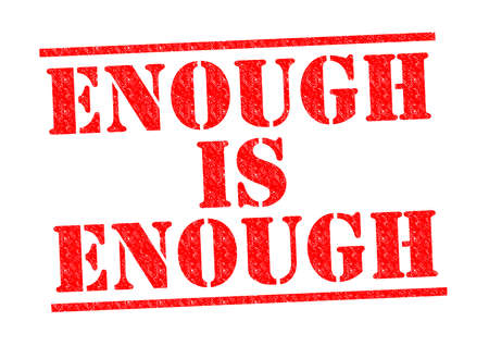 ENOUGH IS ENOUGH red Rubber Stamp over a white background. Reklamní fotografie