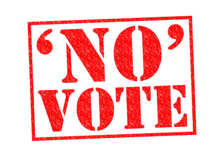 NO VOTE red Rubber Stamp over a white background. photo