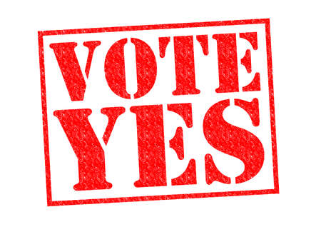 VOTE YES red Rubber Stamp over a white background. Stock Photo