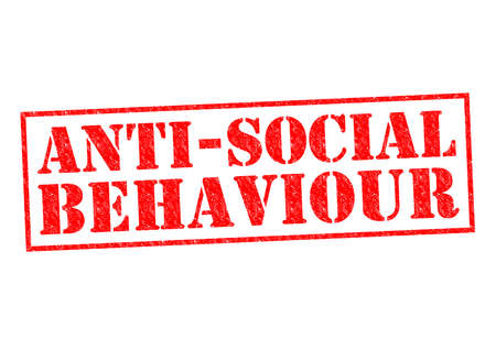 antisocial: ANTI-SOCIAL BEHAVIOUR (English spelling) red Rubber Stamp over a white background. Stock Photo