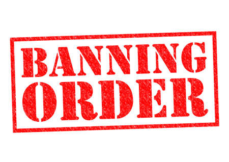banning the symbol: BANNING ORDER red Rubber Stamp over a white background. Stock Photo